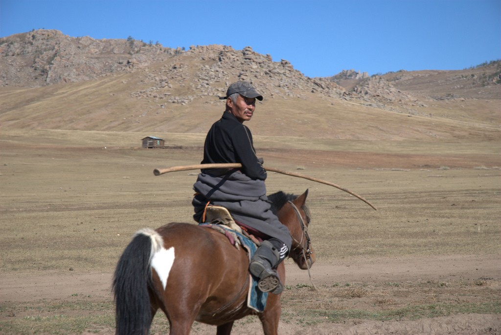 Mongolian farmer on a horse