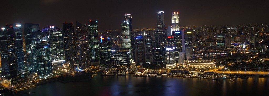 Singapore skyline panorama by night