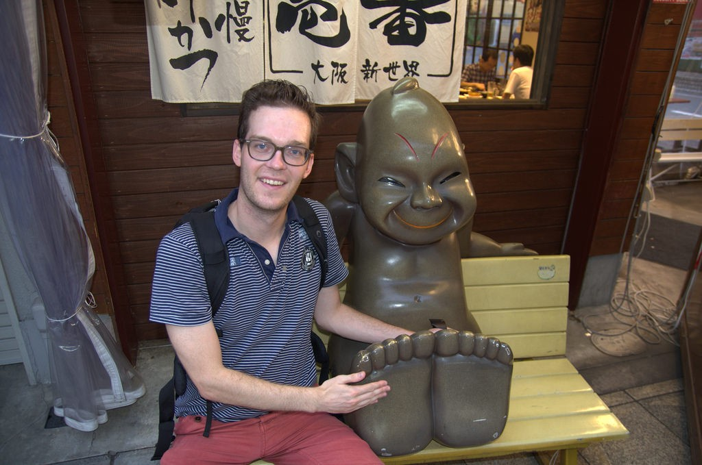 Touching famous Billiken